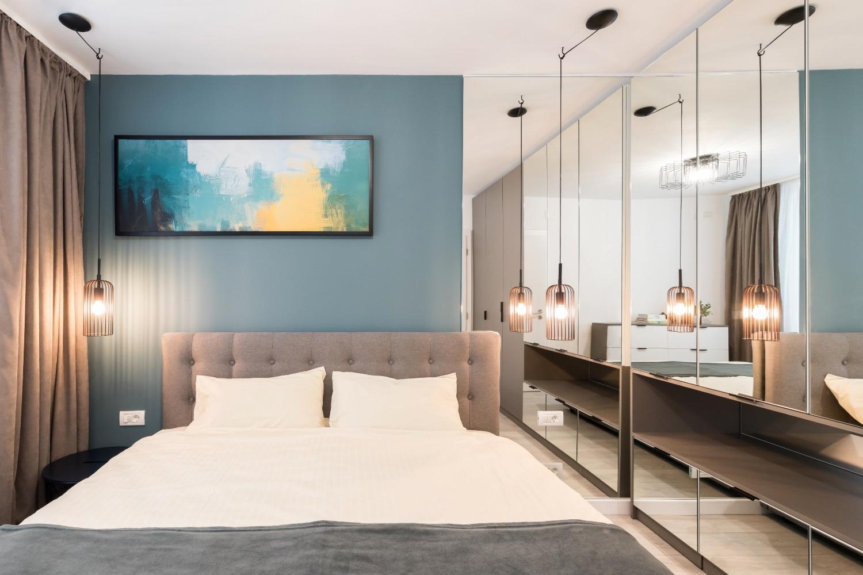 Renovare apartament Militari Vim Studio - dormitor pat gri