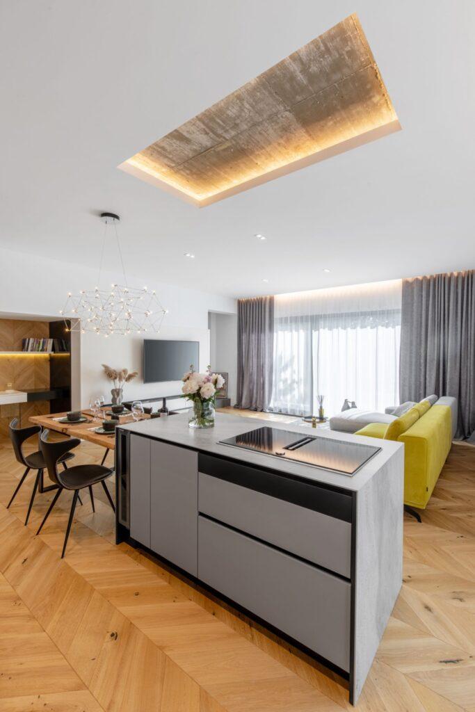 Amenajare vila duplex Otopeni stil eclectic - Sergiu Califar - Pure Mess Design - bucatarie minimalista cu insula ciment (4)